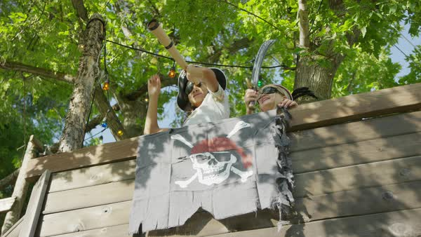 Children playing in pirate ship tree house / Provo, Utah, United States Royalty-free stock video