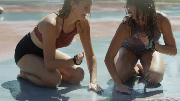 Girls kneeling on wet concrete playing clapping game / Provo, Utah, United States Royalty-free stock video
