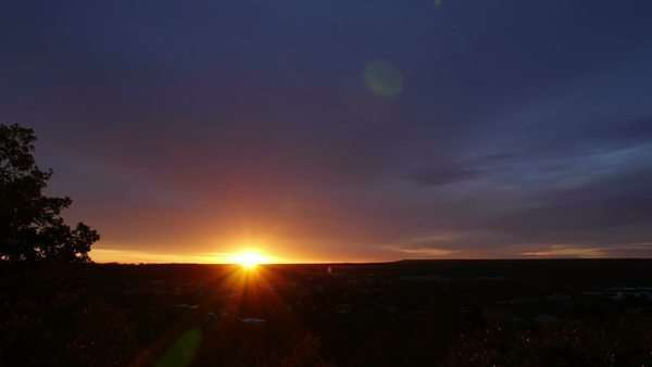 Beautiful sunrise over Flagstaff, Arizona, with a layer of clouds above. High angle, timelapse. Royalty-free stock video