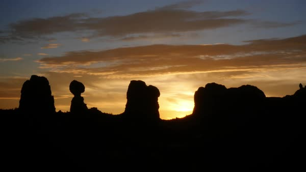 Brilliant sun rises over unique rock formations in the Desert Southwest Royalty-free stock video