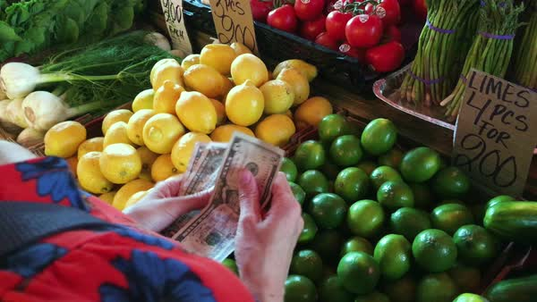 Medium close-up shot of a woman shopping at a market Royalty-free stock video