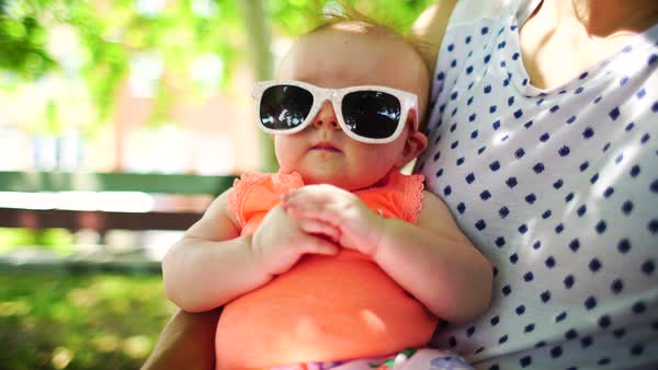 Medium shot of a baby wearing sunglasses Royalty-free stock video