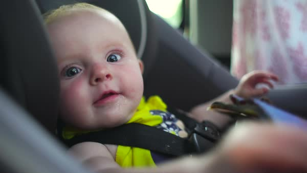 Hand-held close-up of baby looking at camera Royalty-free stock video
