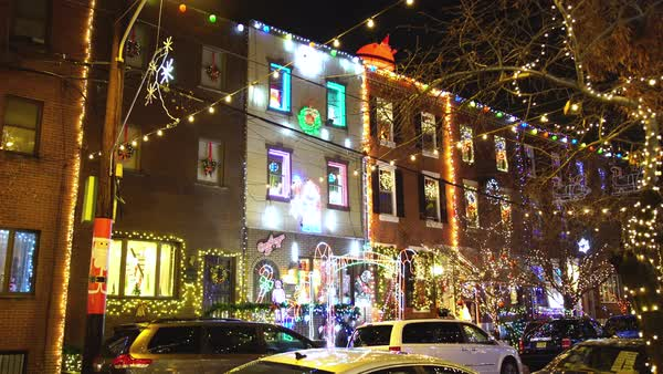 Gimbal shot of row houses decorated for Christmas Rights-managed stock video