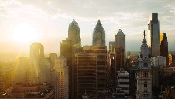 Zoom out timelapse of Philadelphia skyline with bright shining sun Rights-managed stock video