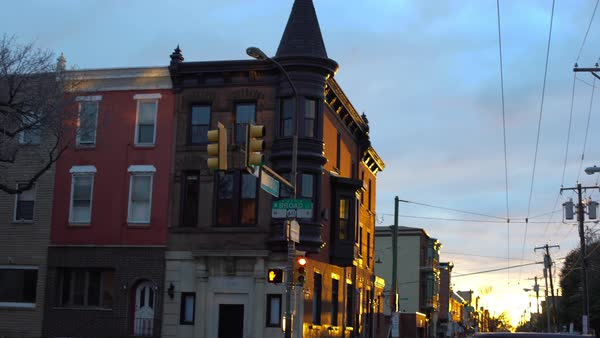 Wide shot of a road at sunset in Philadelphia, Pennsylvania, USA Rights-managed stock video