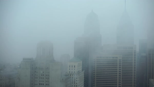Medium shot of buildings shrouded in fog in Downtown Philadelphia Rights-managed stock video