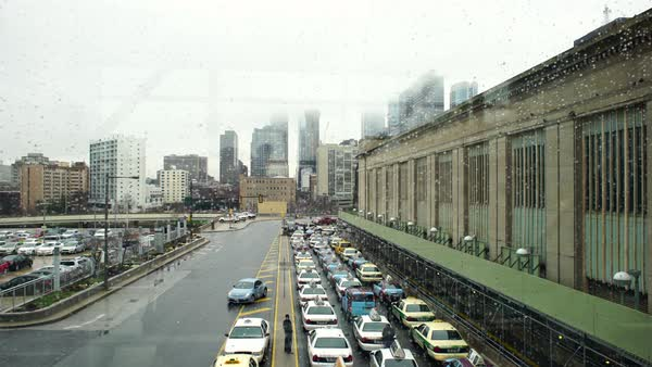 Wide shot of cars parking at the 30th Street Station in Philadelphia Rights-managed stock video