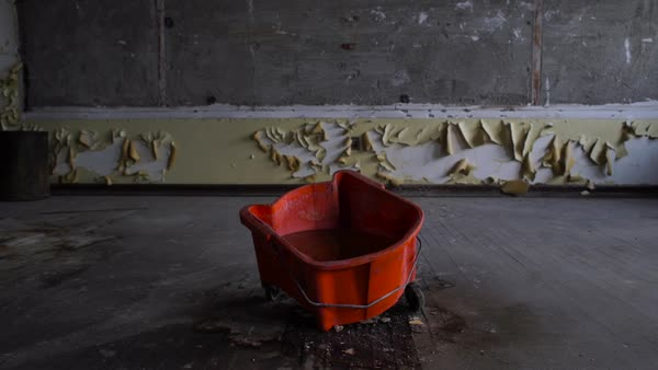 Wide shot of a bucket in an abandoned class room in Bok School, Philadelphia Rights-managed stock video
