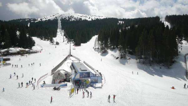 Aerial view of people skiing and ski lift at mountain ski resort. Royalty-free stock video