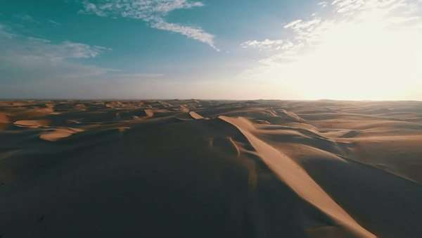 Sunrise over aerial shot of large sand dune in the desert Royalty-free stock video