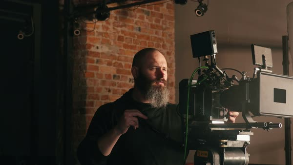 Camera operator panning left and right with large dolly rig Royalty-free stock video