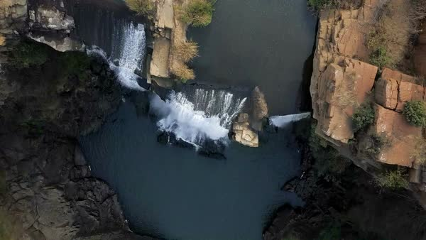 Flying over waterfall looking directly down into gorge Royalty-free stock video