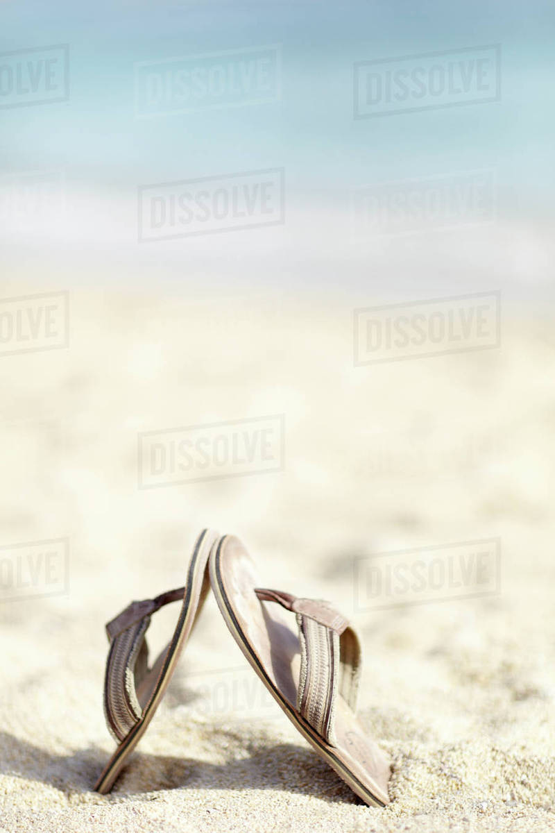47136c572d97c Flip flops on beach - Stock Photo - Dissolve