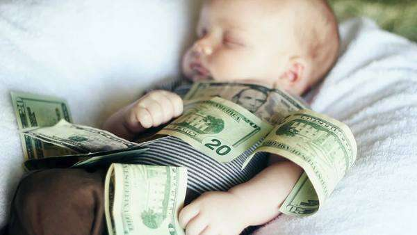 A baby lying in a pile of cash Royalty-free stock video