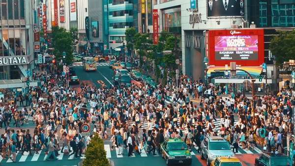 Pedestrians crossing one of the busiest crosswalks in the world in the Shibuya district of Tokyo, Japan. Timelapse Royalty-free stock video