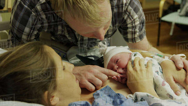 High angle view of new mother and father admiring newborn baby in hospital Royalty-free stock photo