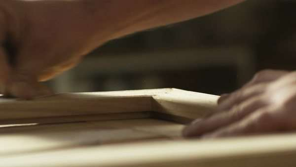 Carpenter woodworking on a door Royalty-free stock video