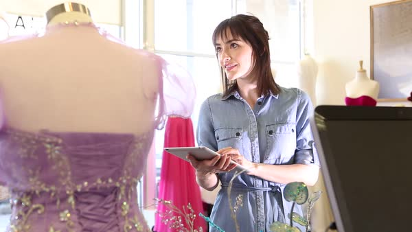 Young woman owner of a bridal shop using a digital tablet Royalty-free stock video