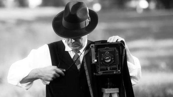 40s era photographer takes a photo and them looks at the scene black and white version Royalty-free stock video