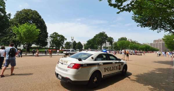 WASHINGTON, D.C. - July, 2015 - A police car monitors tourists and visitors in front of the White House in Washington, D.C. Royalty-free stock video