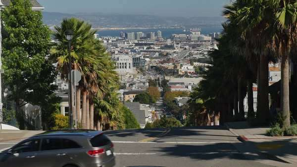 SAN FRANCISCO - Circa October, 2015 - A daytime establishing shot of a very steep street in the residential area of Cole Valley.    Royalty-free stock video