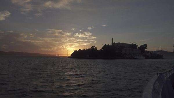 SAN FRANCISCO, CA - Circa October, 2015 - Alcatraz Island as seen at sunset from a passenger ferry. Royalty-free stock video