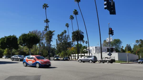 A typical intersection in the upscale Beverly Hills area of Los Angeles.  	 Royalty-free stock video