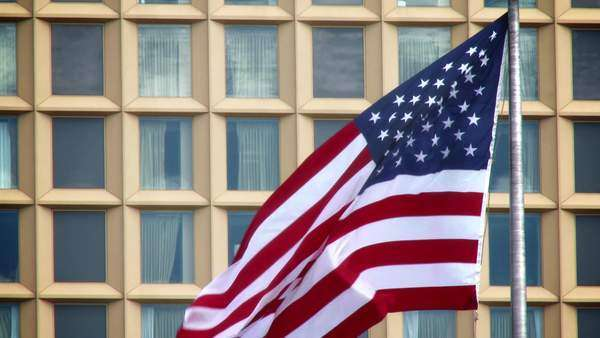 An American flag blowing in the wind in downtown Pittsburgh. Royalty-free stock video
