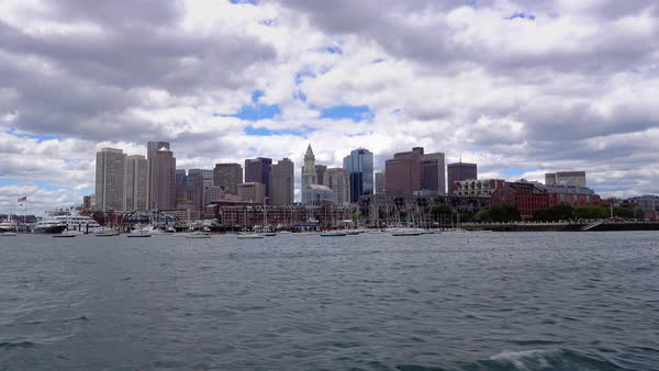 A daytime establishing shot of the Boston skyline as seen from the harbor.    Royalty-free stock video