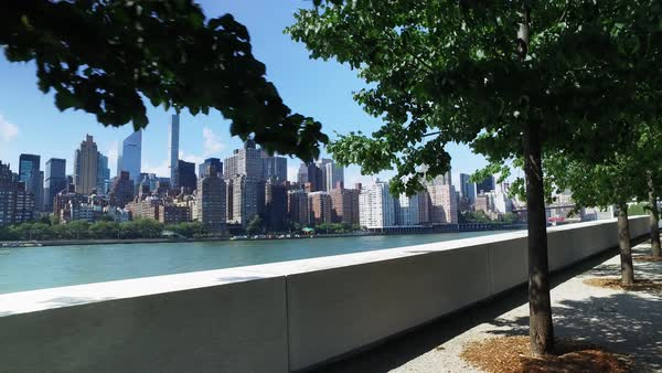 The midtown Manhattan skyline as seen from the treelined paths at Franklin D. Roosevelt Four Freedoms Park on the south end of Roosevelt Island.	 	 Royalty-free stock video