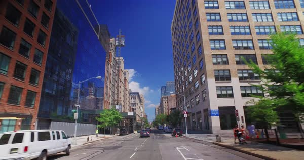 NEW YORK - Circa August, 2016 - A forward perspective view of driving through a typical downtown Manhattan neighborhood.	 	 Royalty-free stock video