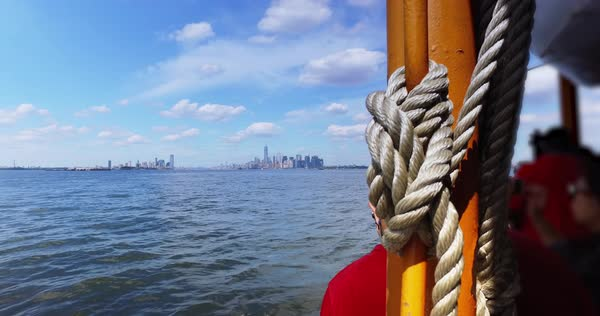 A daytime establishing shot of the lower Manhattan and Jersey City skyline as seen from the Staten Island Ferry on New York Harbor.	 	 Royalty-free stock video