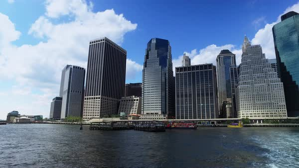 A daytime establishing shot of the lower Manhattan skyline as seen from the East River Ferry.  	 Royalty-free stock video
