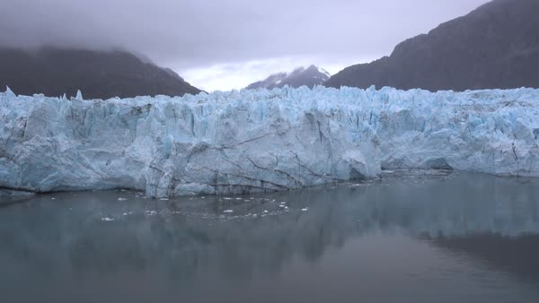 A foggy daytime establishing shot of Margerie Glacier in Glacier Bay, Alaska.  	 Royalty-free stock video