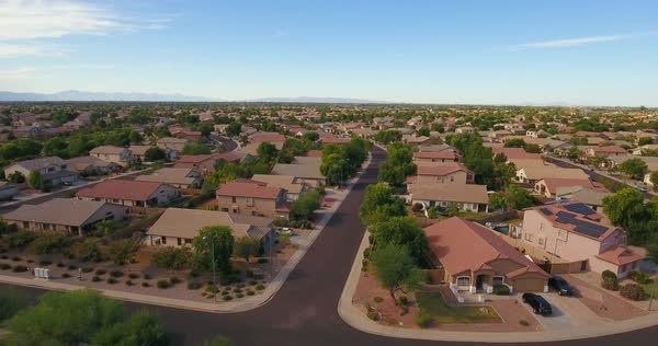 A rising aerial establishing shot of a typical Arizona residential neighborhood. Phoenix suburb.  	 Royalty-free stock video