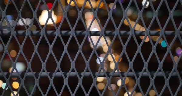 An abstract view of bokeh traffic on San Diego's Fifth Avenue as seen through a fence.  	 Royalty-free stock video