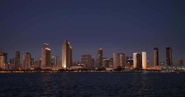 SAN DIEGO, CA - Circa February, 2017 - A picturesque establishing shot of the San Diego skyline at night. Royalty-free stock video