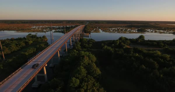 An early morning sunrise aerial establishing shot of the Topsail Island Bridge over the Intracoastal Waterway. Royalty-free stock video