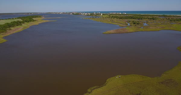 A daytime aerial establishing shot over the Topsail Island shoreline in North Carolina.  Royalty-free stock video