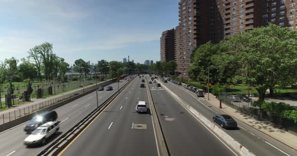 A high angle daytime establishing shot of traffic passing on FDR Drive on Manhattan's east side. Royalty-free stock video