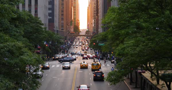 A slow motion evening establishing shot looking down 42nd Street in midtown Manhattan at sunset. Shot at 48fps. Royalty-free stock video