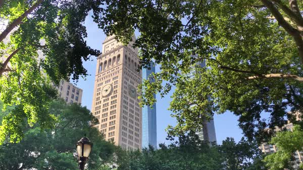 A cinematic morning establishing shot of the Metropolitan Life Insurance Company Tower as seen from Madison Square Park in Manhattan.  Royalty-free stock video