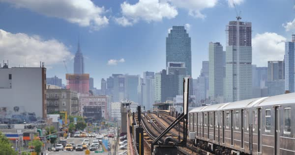 A view of the Manhattan skyline as seen from an elevated subway platform over Queens Boulevard in Queens.  Royalty-free stock video