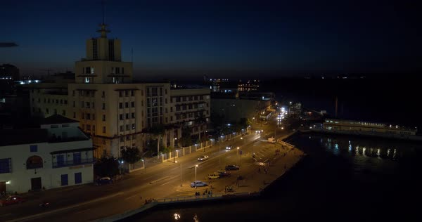 A dusk or evening establishing shot of the Havana Port Bay shoreline.  Royalty-free stock video
