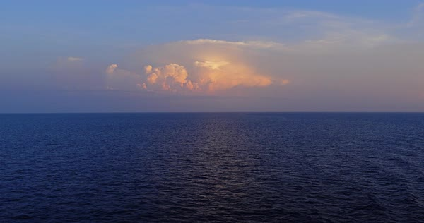 A peaceful sunset view of the horizon over the open ocean Royalty-free stock video