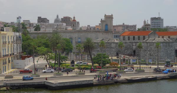 A high angle day dolly establishing shot of the shoreline of Havana, Cuba. Royalty-free stock video