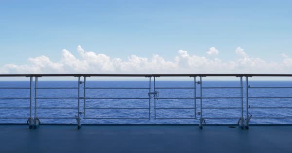 A static daytime establishing shot looking at the open ocean from the deck of a cruise ship.  Royalty-free stock video