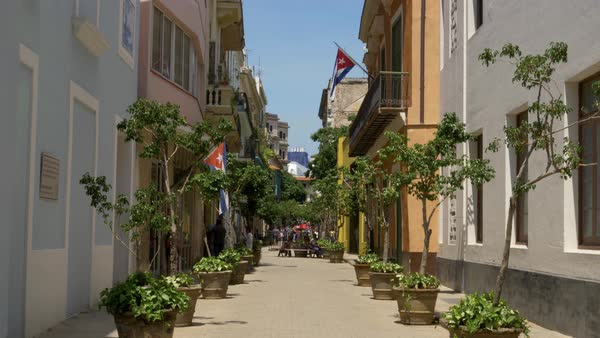 A daytime exterior establishing shot of a typical narrow street in the old town tourist district of Havana, Cuba. Royalty-free stock video