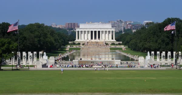 WASHINGTON, D.C. - Circa August, 2017 - A sunny daytime long shot of tourists visiting the Lincoln Memorial on the Washington Mall. Shot at 48fps.   Royalty-free stock video